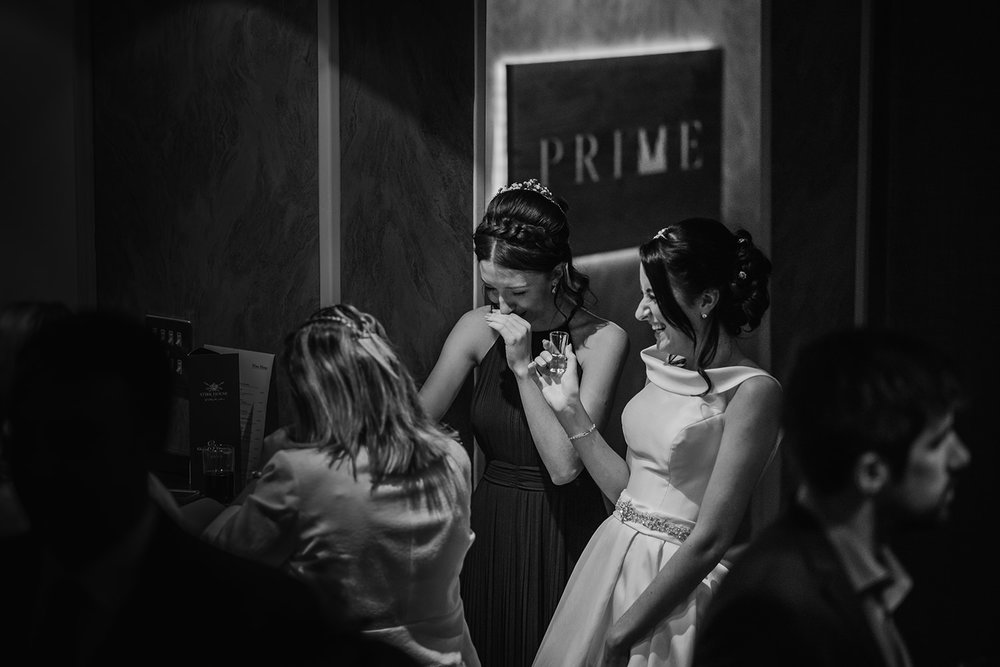 bride and bridesmaids having a shot at the bar