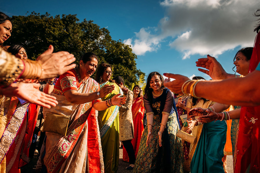 Colourful photo of Indian ladies doing a traditional dance