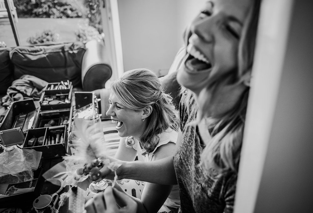 black and white photo of girls laughing