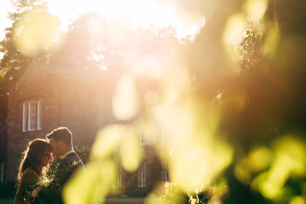 couple in nice sunlight in front of Browsholme hall