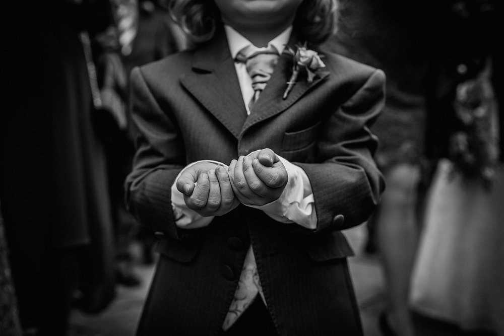 close up of kid's hands holding confetti