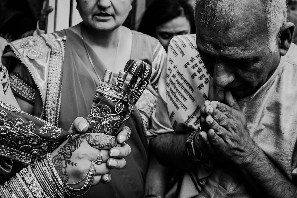 Black and white photo of traditions at an Indian wedding