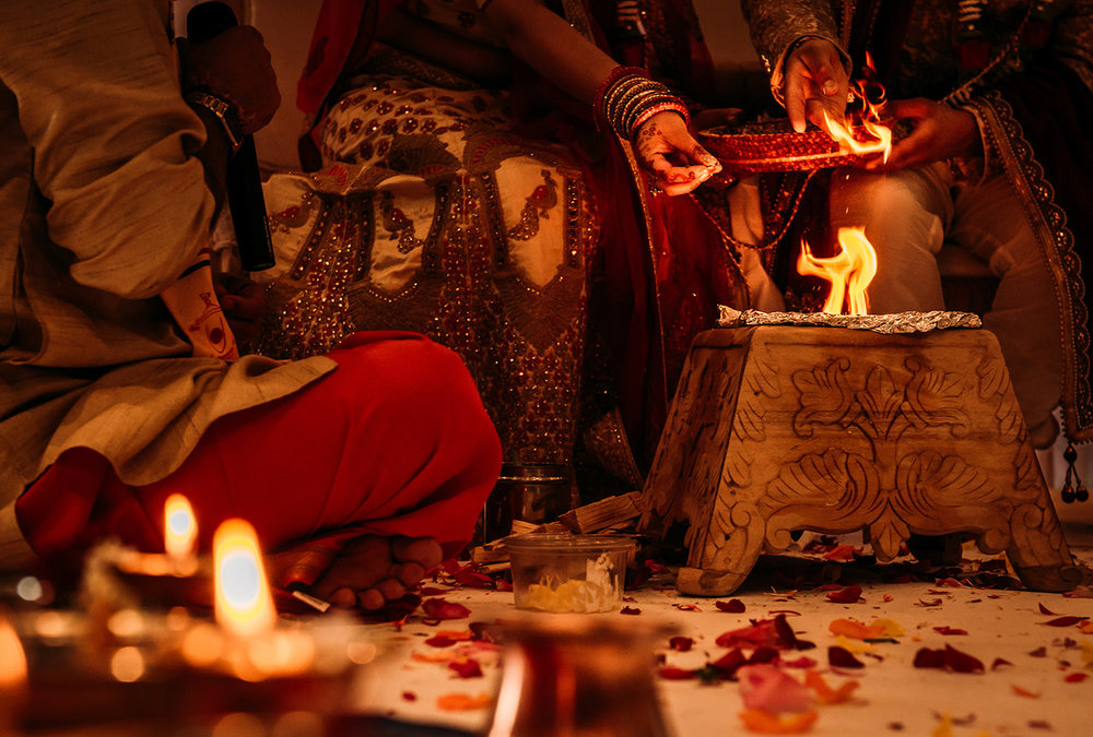 throwing cumin into flames at Indian wedding