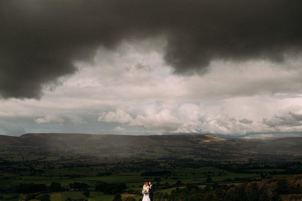 couple standing in the huge scenery of Jeffrey hill