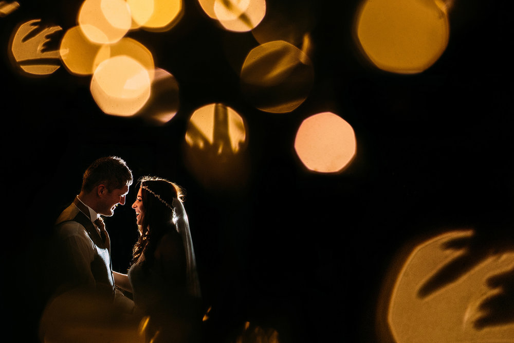 Christmas tree lights and off camera flash of couple at Shireburn arms
