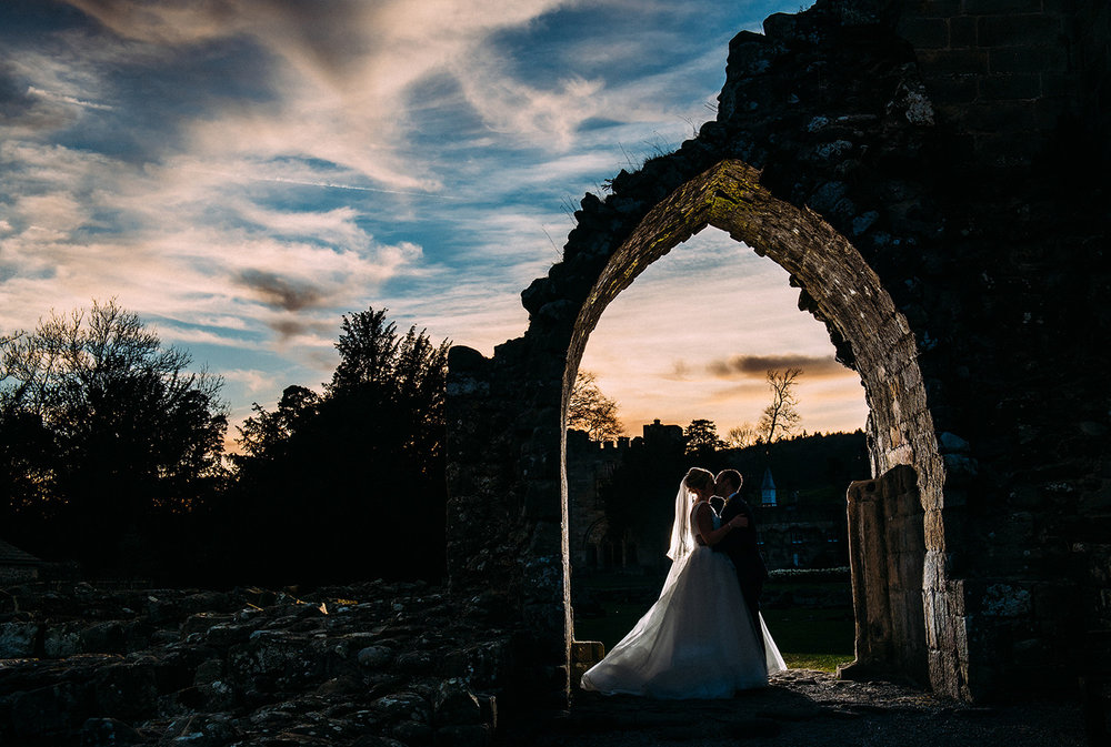 sunset shot of bride and groom at Bolton abbey