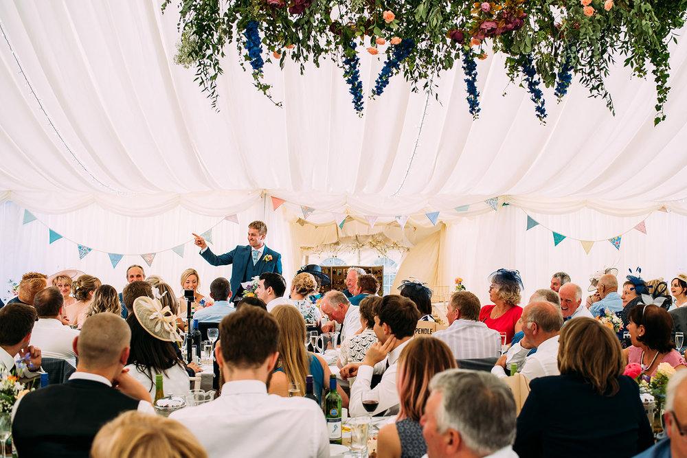 wide shot of groom giving his speech