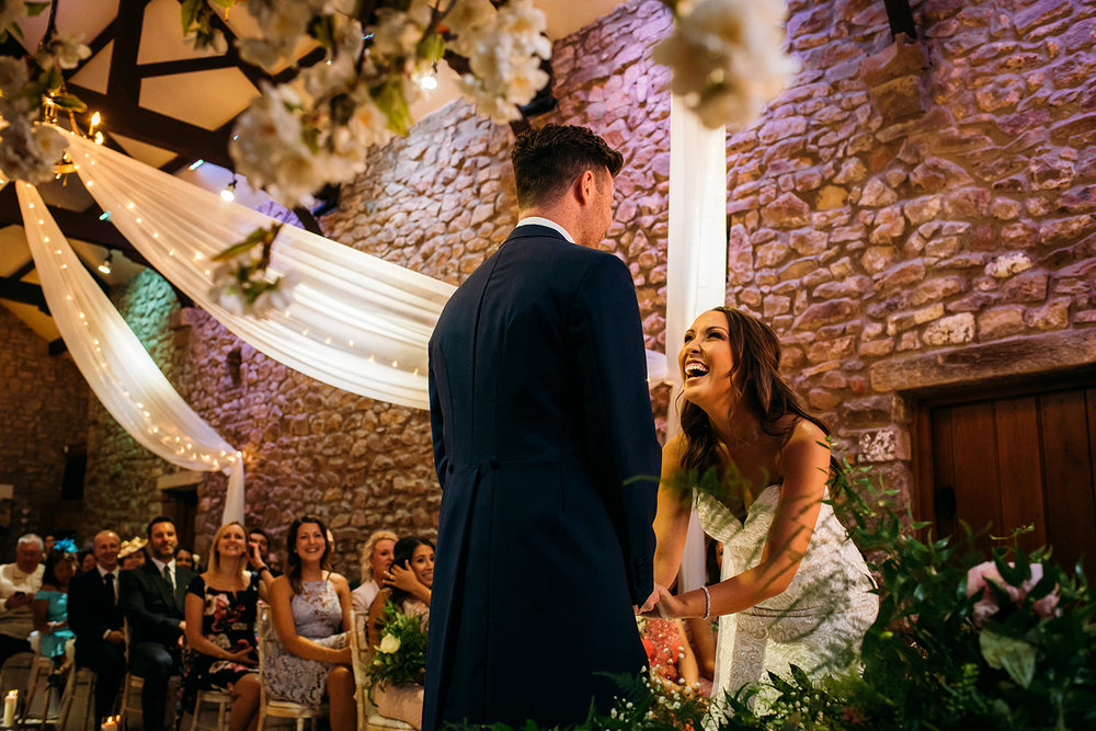 bride and groom laughing during wedding service at Browsholme hall