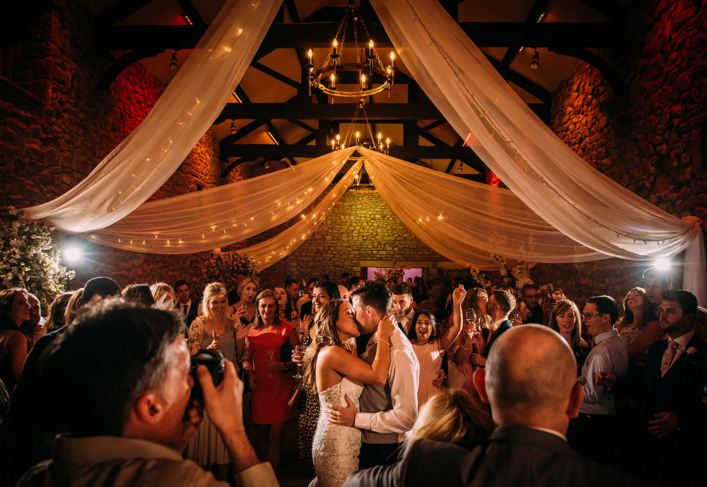 first dance kiss in tithe barn at Browsholme hall.