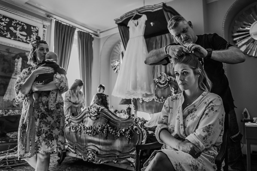 busy black and white bridal prep shot