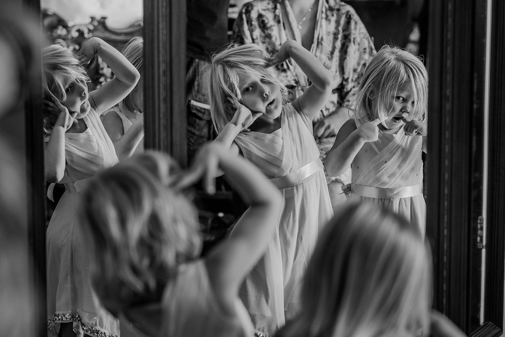 black and white of girls being silly in the mirror