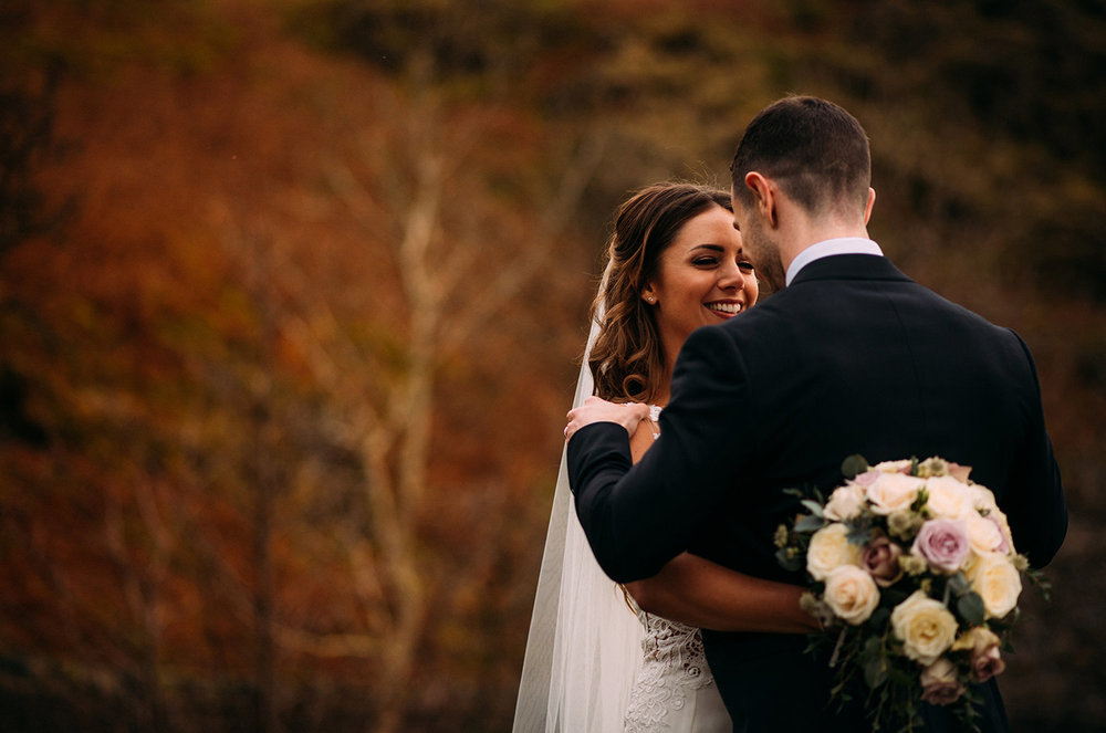 bride smiling at groom at Buttermere lake