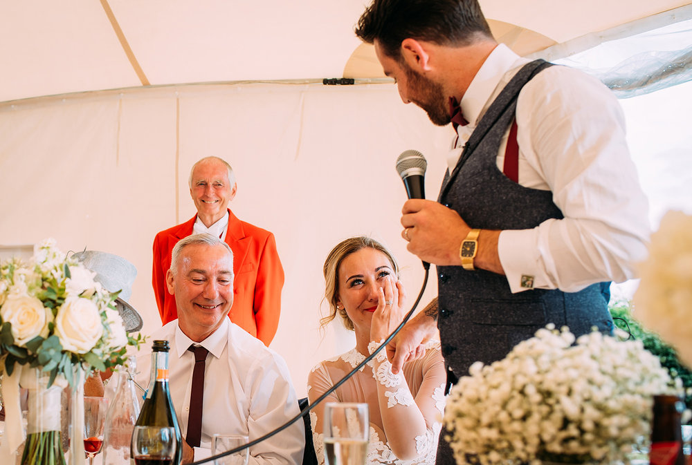 groom speech making his bride emotional