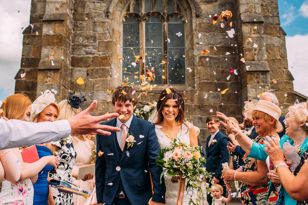 bride and groom confetti shot at St Helen's church, Waddington