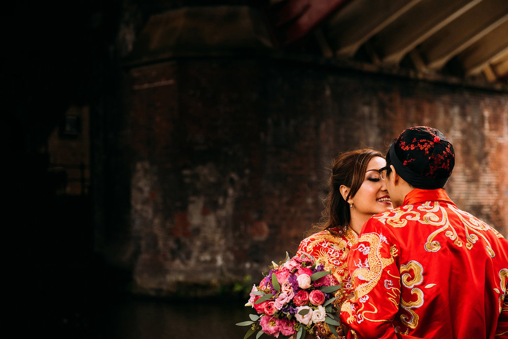 Chinese couple in industrial Castlefield canal setting