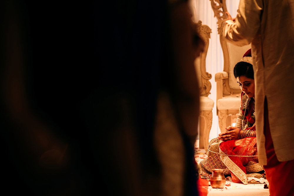 Bride praying during Indian wedding celebrations