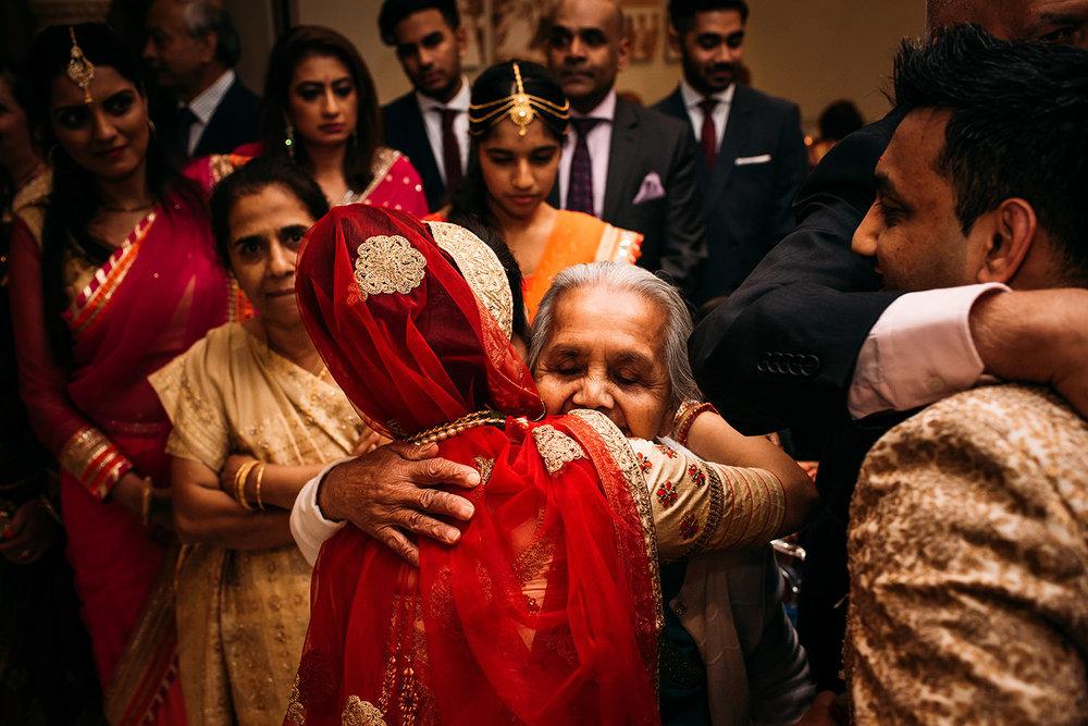 bride hugging relative at Indian wedding