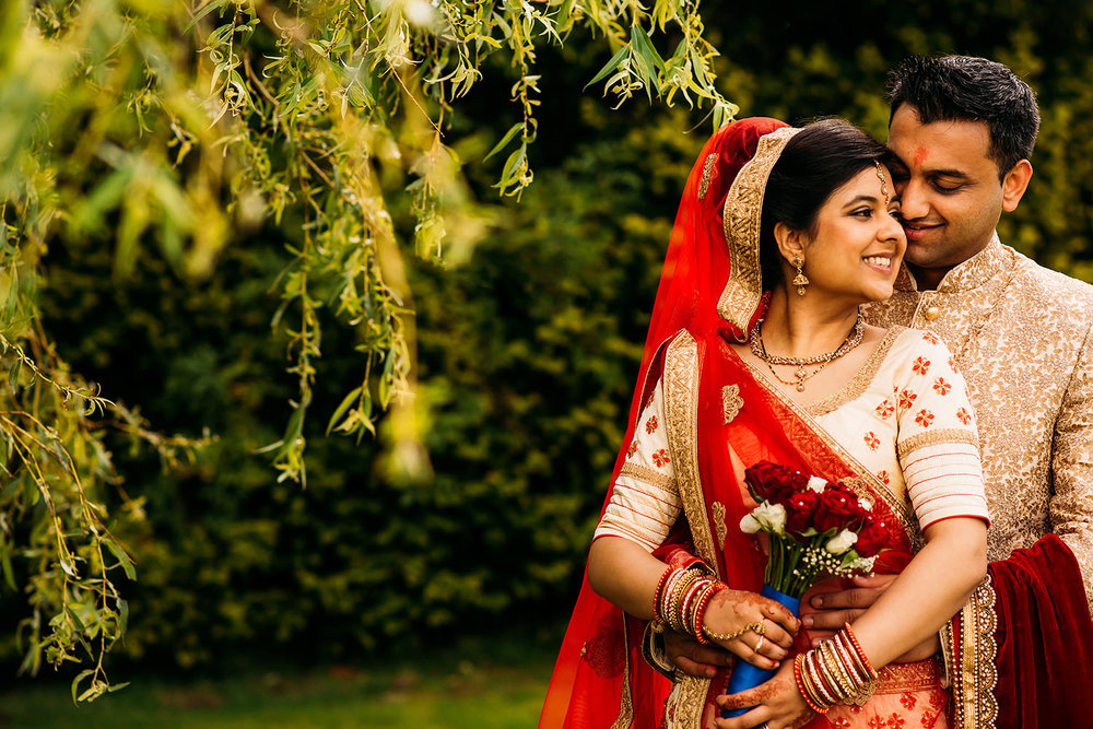 bride and couple in traditional Indian wedding clothes