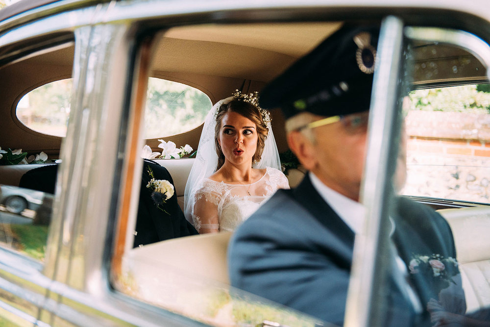 bride arriving in wedding car taking a deep breath