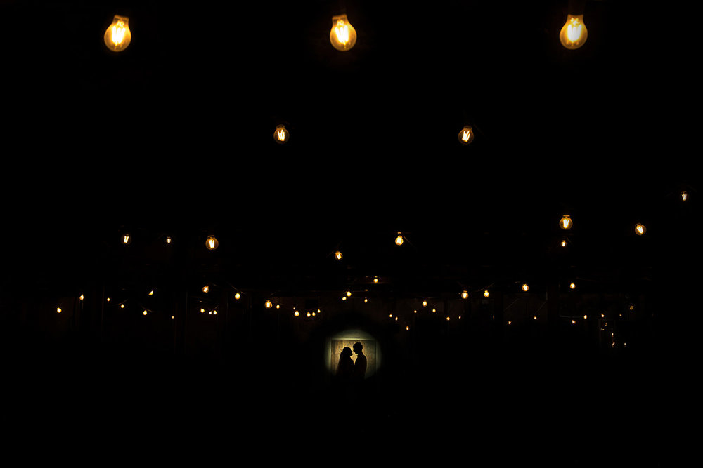 couple silhouette with light bulbs at Holmes mill