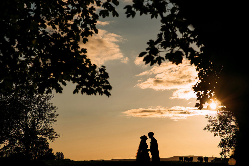 sunset silhouette of couple at Stirk house