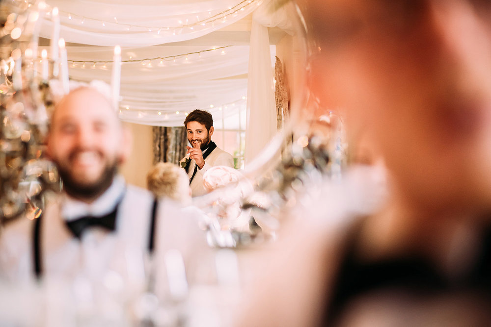 reflection of groom pointing his finger during the speech at Eaves hall
