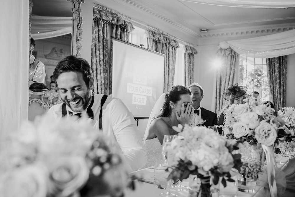 couple laughing during best man speeches at Eaves hall