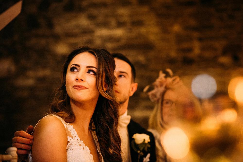 A tear rolls down brides cheek during fathers speech