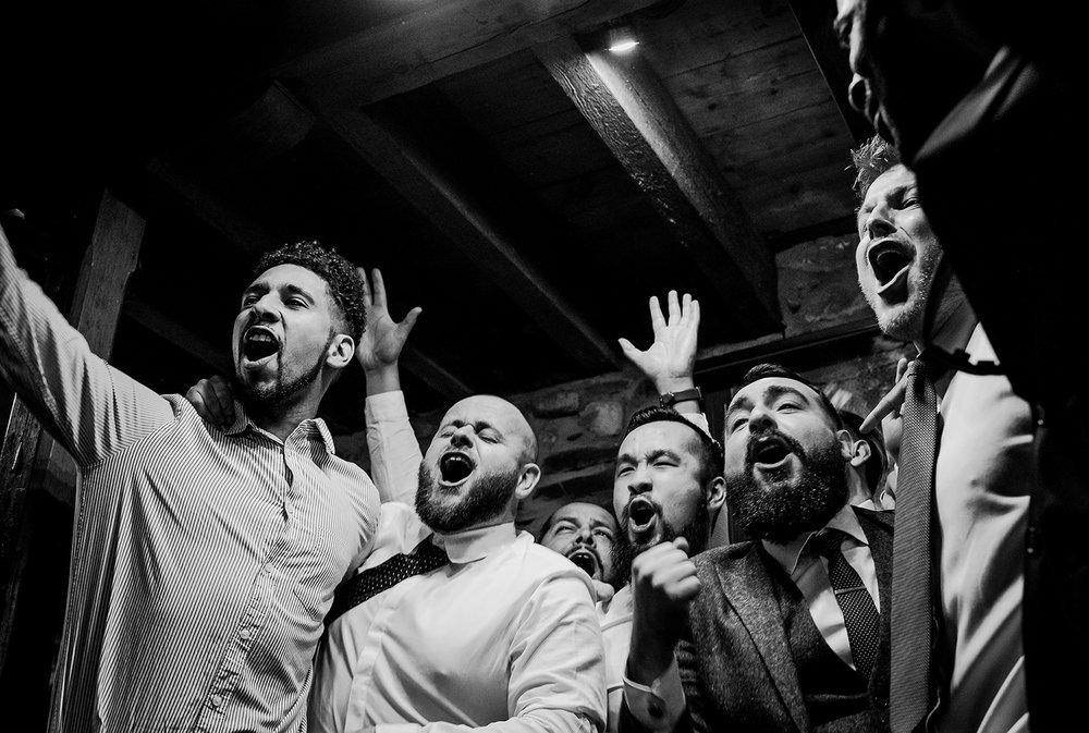 boys singing at wedding - black and photo