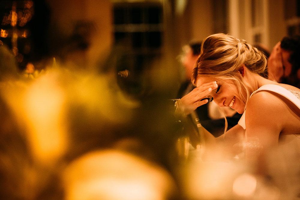 bride during speech shot through candles
