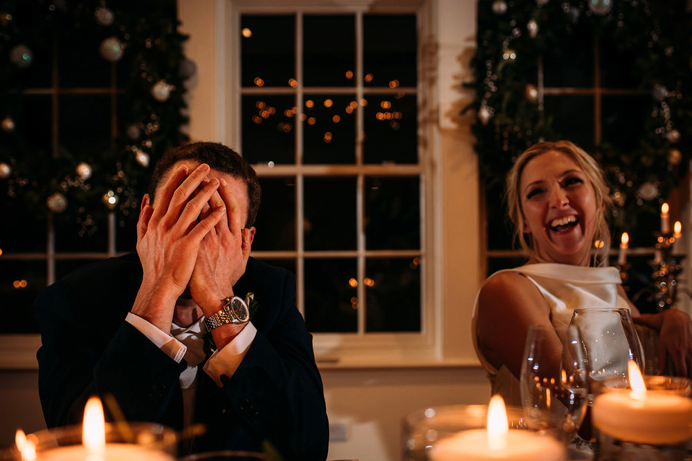 embarassed groom during speeches at Mitton hall