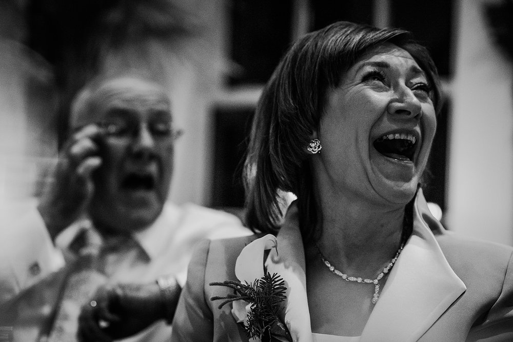 Mother of the bride laughing. BW image