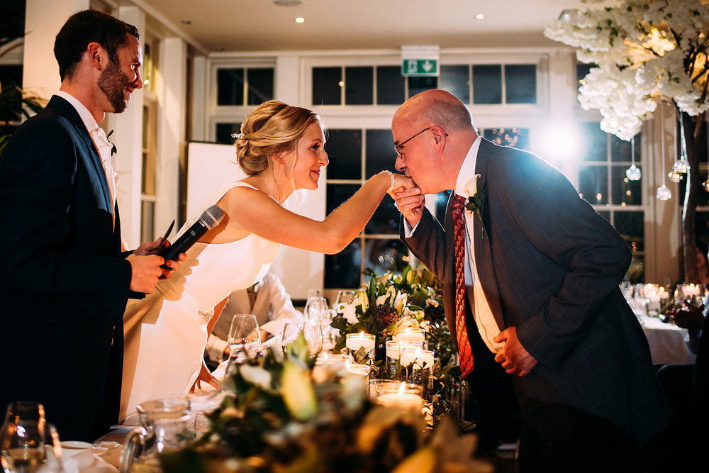 Guest kissing brides hand