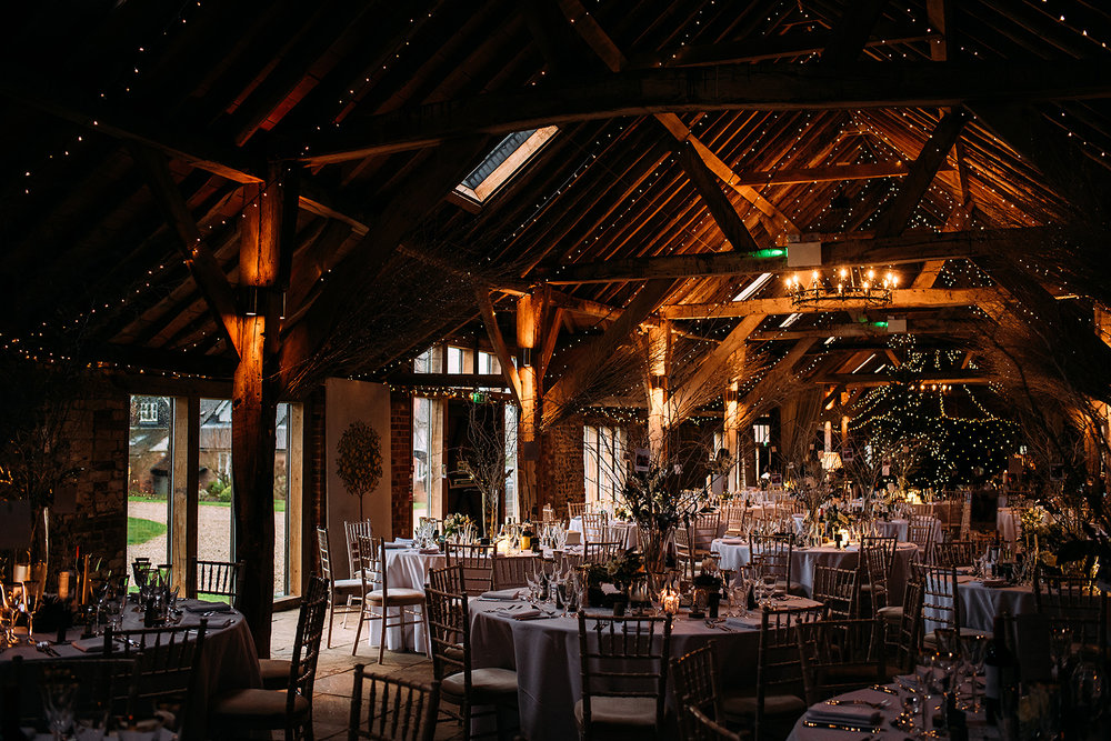 The long barn set for the wedding breakfast