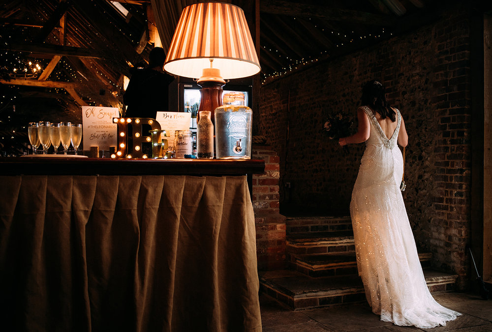 bride walking up steps past window lights