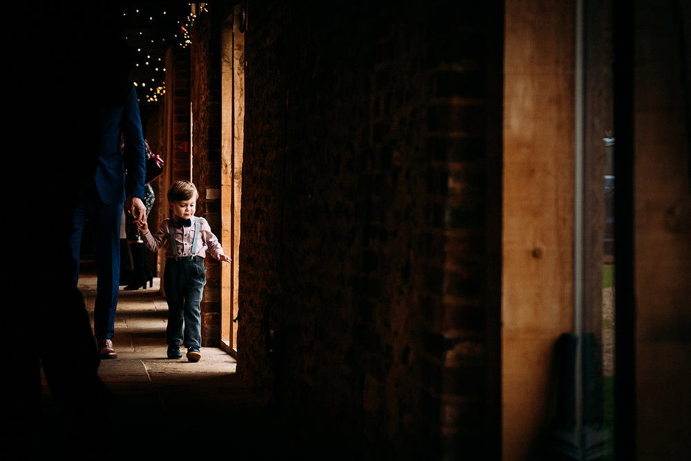 boy walking past window light
