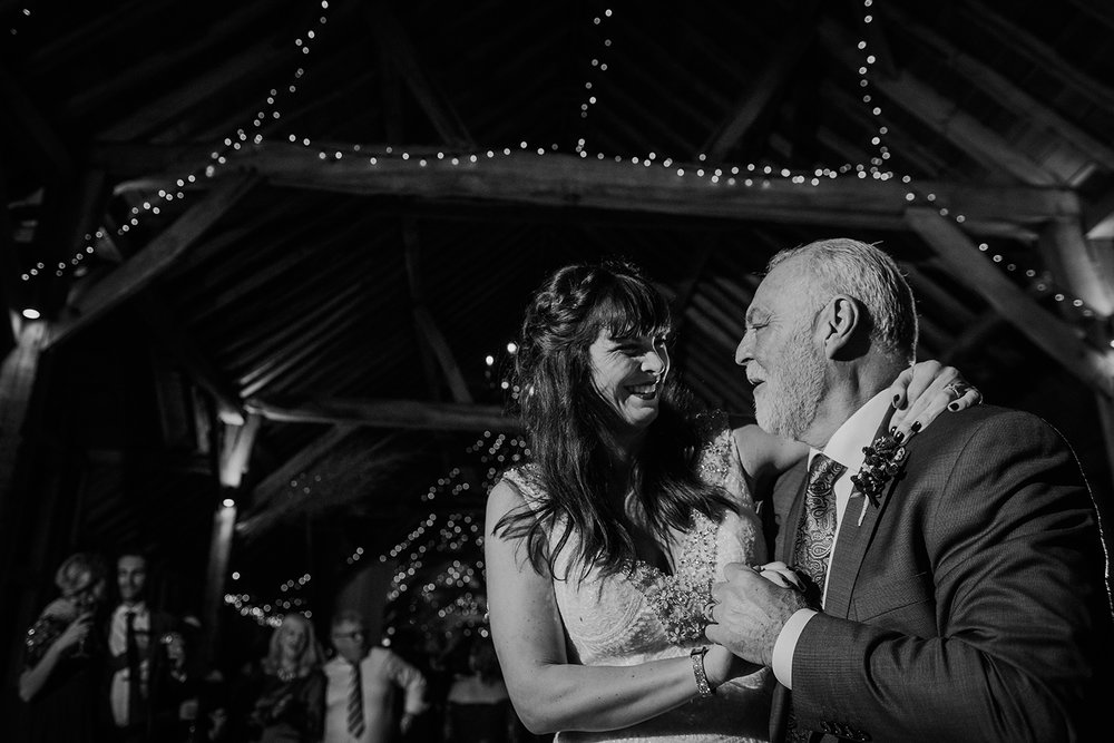 BW photo of bride dancing with father