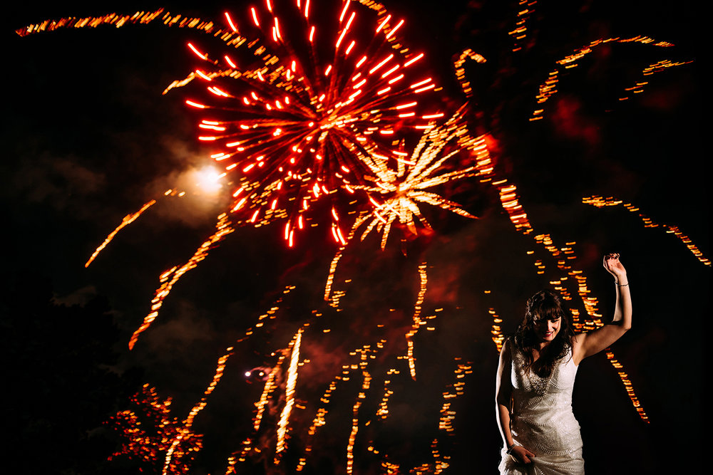 bride dancing under fireworks