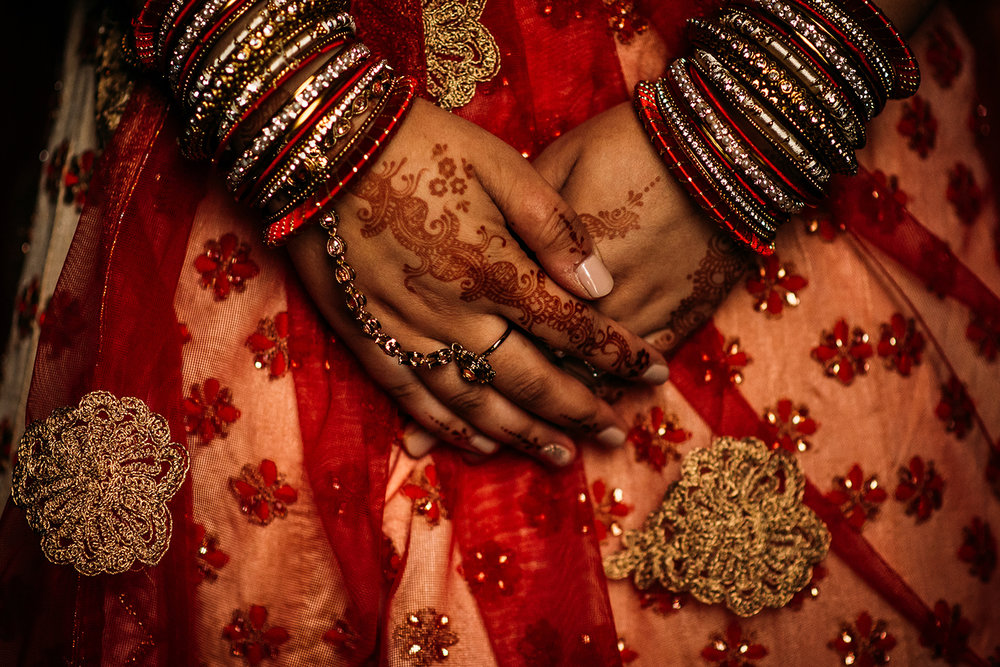 brides hands with henna tattoo's
