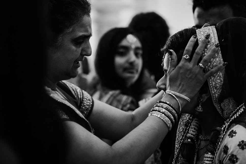 emotional relative embracing the bride. Bw photo