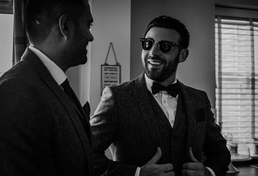 bw photo of the groom with his best man