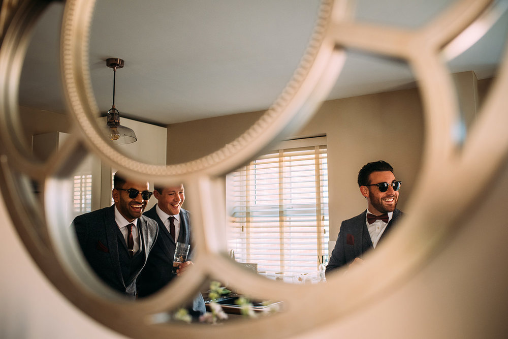 reflection of the guys in a mirror