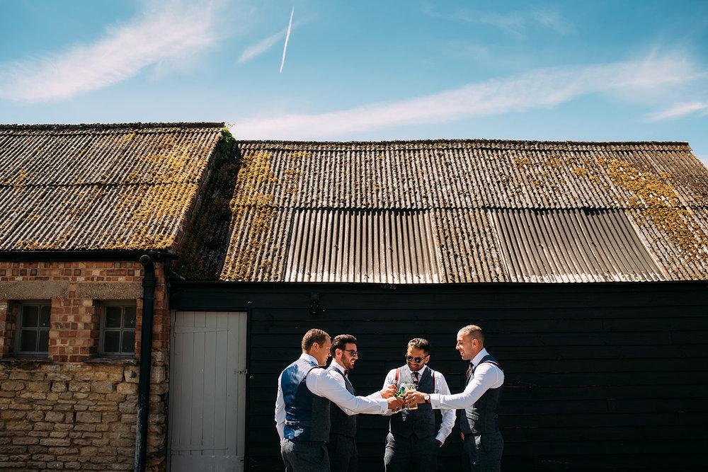groomsmen cheers their glasses