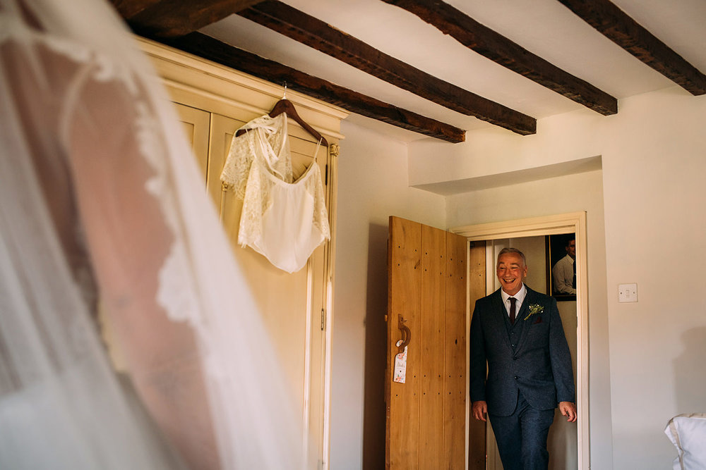 bride's proud father enters the room