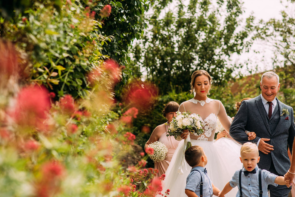 bride and father walking to church