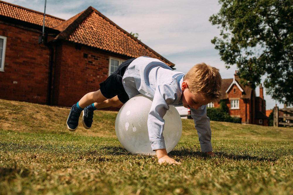 boy bouncing on a balloon