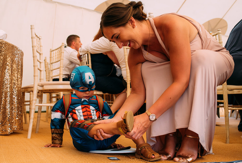 bridesmaid puts her sons 'Captain America' costume on
