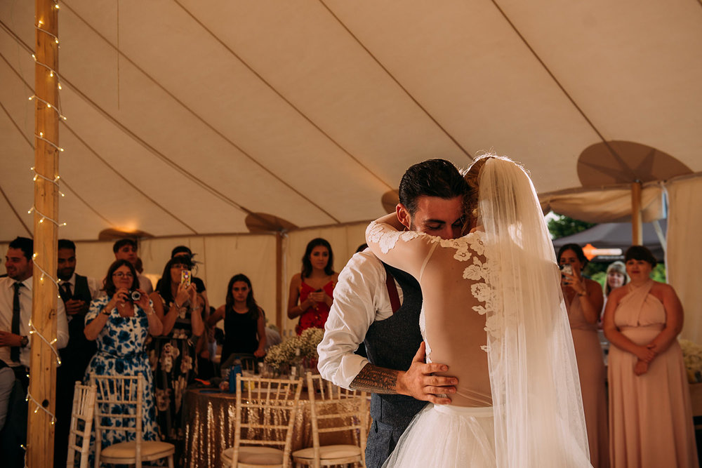 bride and groom embrace during the first dance