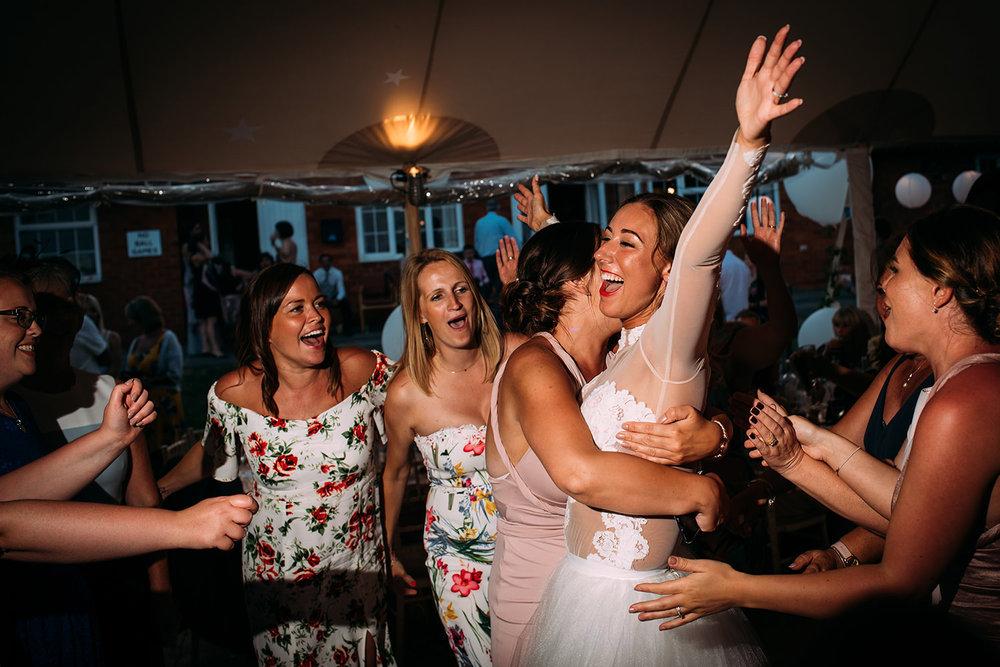 bride hugs her friends