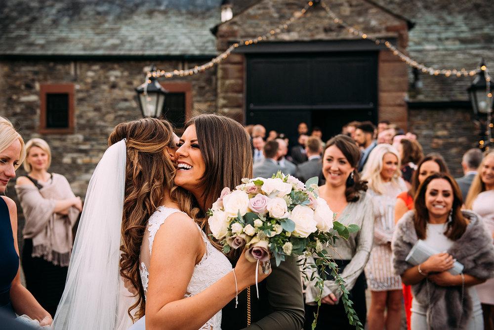 guests hug the bride